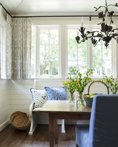 There's something about this that I love.  Add a dash of mid-century and I'm hooked. Banquette from church pew.  black curtain rod hung close to ceiling.  Short casual curtains. //Hughes Lake  Kitchen - Workbook Feature
