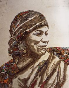"Vik Muniz: Art made from materials from one of the largest garbage dumps on the outskirts of Rio de Janiero, Brazil.  Youth working in the dump collaborated with Muniz to create this work, which is a portrait of a woman who works at the ""wasteland"".  The documentary film ""Wasteland"" won Academy Award for best feature in 2010."