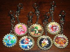 Super Cute and Easy Bottle Cap Key Chains....I want to make some of these so bad. I bought some this summer and they are awesome!