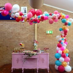 Gravity defying custom bubbly candy inspired one-sided arch for a very special 1st birthday party