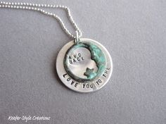 Hand stamped I love you to the moon and back with Patina Moon. $35.00, via Etsy.