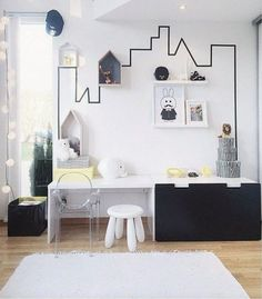 Great use of tape to create an imaginative workspace in a child's room.