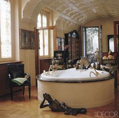 A wall of mirrors visually expands the master bathroom of Donatella Versace's Milan apartment, which... - Provided by ELLE DECOR