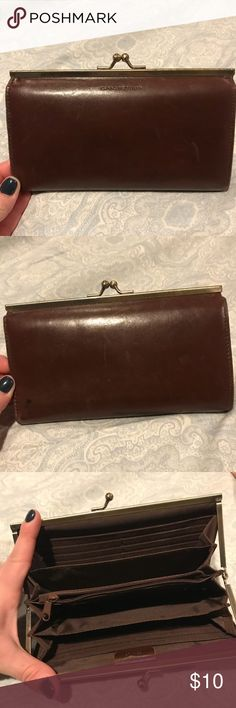 Isaac Mizrahi Brown leather Wallet This Isaac mizrahi brown leather wallet is used with a few markings on it. The inside is flawless. Make me an offer. Isaac Mizrahi Bags Wallets