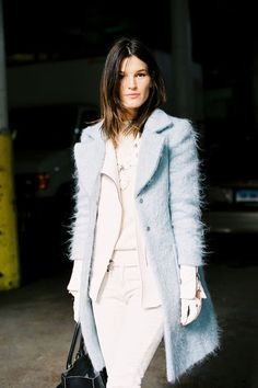 Hanneli Mustaparta...oh so chic in the white leather driving gloves