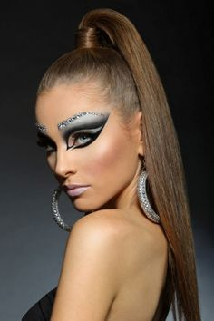 """Dramatic defined grey and black """"cat eye"""" make-up with awesome jeweled eye brows."""