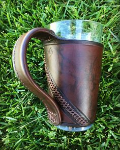 Custom leather pint glass sleeve, made in Montana. That's a fancy beer koozie! Leather Tool Belt, Leather Key Holder, Leather Holster, Leather Art, Sewing Leather, Leather Pattern, Leather Gifts, Custom Leather, Leather Tooling