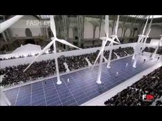 """Chanel"" Spring Summer 2013 Paris Full Show by FashionChannel  The vast Grand Palais spaces barely accommodate Karl Lagerfeld's visionary power who, for this collection, has created an enchanted forest of wind turbines rising from a catwalk lined with solar panels. The minimalist design of the eco-technological theme combined with the concept of..."