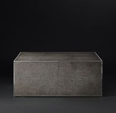 RH Modern's Shagreen Cube Square Coffee Table:A 1970s interpretation of French Art Deco design, our table from Anthony Cox celebrates the marriage of two eras. With elegant materials and a refined form, it's clad in rich faux shagreen and accented with metal trim detail.