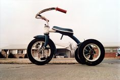 "William Eggleston iconic ""Tricycle"". Eggleston is responsible for legitimizing the use of color photography in Fine Arts photography."
