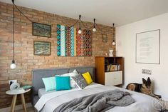 Love the brick wall, color patterns and the dog and everything in this bedroom. Flat in Chorzov, Poland designed by Widawscy Studio Architektury. Photo by Tomasz Borucki.  #bedroom #bedroomdecor #brick #brickwall #colors #patterns #interior #interiors #interiordesign #interiorstyle #interiorstyling #home #living #homedesign #homedecor #deco #decor #designed #decoration #designs #poland #polska #flat