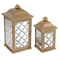 Showcasing an elegant gold finish and trellis-motif glass, these 2 beautiful candle lanterns cast a lovely glow on your entryway console or mantel.