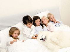 Katrina Tang Photography for Amiki Children Sleepwear AW 13. Kids sleeping in a white bed with a dog #katrinatang #tangkatrina