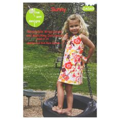 Olive Ann Designs Sunny Reversible Dress Pattern from @fabricdotcom  Designed by Olive Ann Designs, this pattern contains detailed instructions and pattern pieces to make your own reversible wrap dress and matching doll dress.  Sizes range from girls 2-10.  <br><a href=https://s3.amazonaws.com/fabric-pdf/0333174-1.jpg>Click here for pattern back.</a>