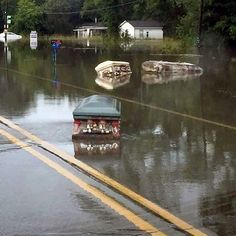08/15/2016 - Macabre scenes as COFFINS float down streets in deadly Louisiana floods that have killed five people and left 20,000 needing rescue - grisly images surface as President Obama declares state of emergency