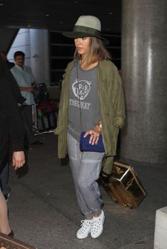Jess dons a statement sweatshirt with an army jacket thrown over.