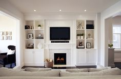 Ideas for contemporary fireplace with built-ins and TV nook. Love the simple design/style of the built-ins. Tv Over Fireplace, Fireplace Built Ins, Home Fireplace, Living Room With Fireplace, Fireplace Design, Fireplace Bookcase, Fireplaces, Fireplace Ideas, Farmhouse Fireplace