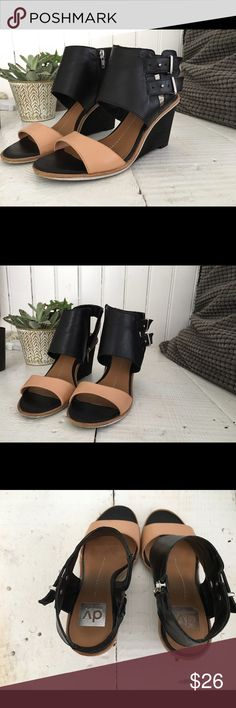 Dolce Vita buckle wedge heels Dolce Vita ankle wedges. Nude and black. Two small buckles on outside of ankle give a moto look, zipper on inside of ankle for actual closure. A little bit of a rock'n'roll vibe at night but also can be casual with boyfriend jeans and a matching nude top. Great used condition. Some wear in the soles as shown DV by Dolce Vita Shoes Wedges