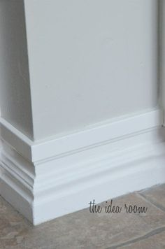 Upgrade builder's grade baseboards without replacing - just add a strip of molding an inch above the original baseboard an paint - genius!