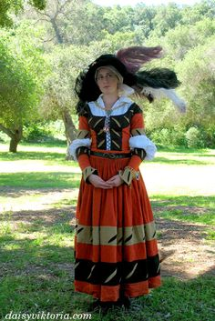 This is 16th century German Landsknecht dress, worn by the kampfrau.  FAERIE QUEEN COSTUMING http://www.faerie-queen.com/