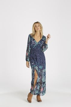 Deep water blues meet bohemian florals in the 'Dreaming Away Maxi Dress'.