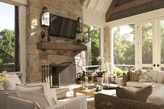 Screened porch, timber mantel, natural light, sconces, outdoor fireplace