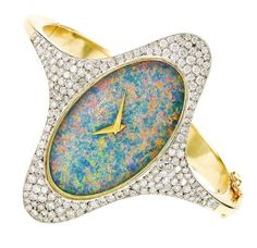 CHOPARD A LADY'S YELLOW AND WHITE GOLD, DIAMOND AND OPAL-SET ELLIPSE BRACELET WATCH - CIRCA 1970 •