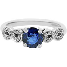 A stunning and unique engagement ring, crafted in platinum and set with a beautiful round brilliant cut blue Sri Lankan sapphire at its centre. With an infinity symbol on each shoulder, grain set with small Australian diamonds.
