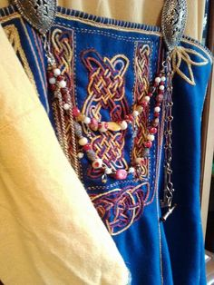 Hand embroidered apron front by pinner Dena Morford.