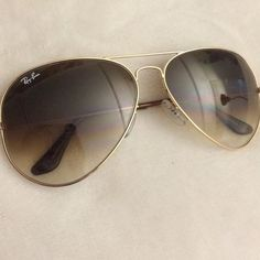 Ray-Ban aviators Large frame-gold aviators. These Ray-Bans have only been worn a couple of times and are in great condition. No scratches or bends! Ray-Ban Accessories Sunglasses
