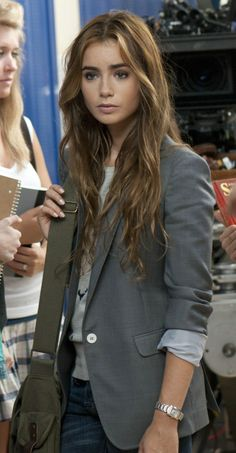 Lily Collins in Abduction (Cheesy Film).  Love her long hair!