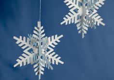 A 3D Christmas paper snowflake ornament. Free template and die cut files are included.