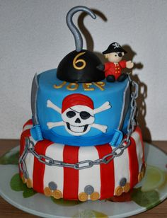 "Pirate theme cake - My very first cake made for someone other than family members. The little boy's birthday party had ""Pirates"" as the theme, so his mother asked me for a Pirate Cake for his birthday."