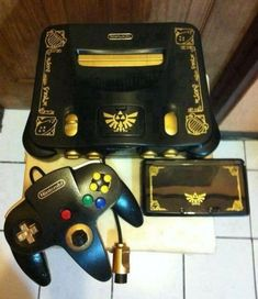 tinycartridge: Matching limited edition Zelda 3DS and N64 I don't know who made this, but much props to them for replicating the Ocarina of Time 3DS design with a custom N64 paintjob. I love the idea of making skins based on one console's limited edition release, and applying them on other systems. BUY Hyrule Historia, Legend of Zelda: Ocarina of Time 3D