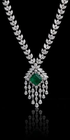 A CLASSIC PENDANT NECKLACE A classic emerald and diamond pendant necklace set with high quality fancy shaped white diamonds. Emerald Jewelry, High Jewelry, Diamond Jewelry, Gemstone Jewelry, Diamond Pendant Set, Emerald Pendant, Jewellery, Gold Jewelry, Real Diamond Necklace