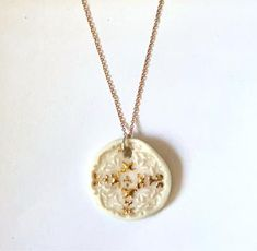 Elegant, organic and modern Porcelain Pendants on a sterling silver chain with mother of pearl and/or 18 carat gold. Being handmade, each pendant in the same style is unique! Made in small batches, while stocks last. If your favourite design is out of stock, sign up to our newsletter to be informed of a new shop update Gold Necklace, Pendant Necklace, Ceramic Studio, Porcelain Jewelry, Carat Gold, New Shop, Mother Pearl, Sterling Silver Chains, Pendants
