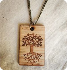 Amazing Tree of life necklace lasercut wooden jewellery by  OneHappyLeaf www.onehappyleaf.etsy.com $29.38