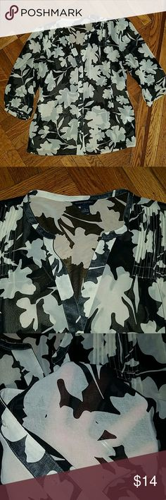 BR floral blouse reposh Semi sheer floral blouse from Banana Republic in perfect condition. Very lightweight and floaty. Wears well with black cami underneath and slacks/leggings or jeans. Tops Blouses