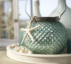 blue glass http://www.potterybarn.com/products/luster-blue-mercury-glass-lanterns/?pkey=cturquoise-shop