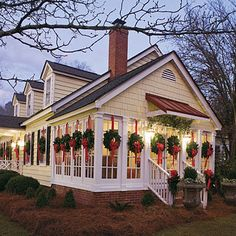 Wreaths on every window. Would love to have a cottage like this to go to for the winter!