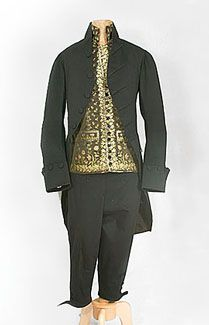 Sir William Lucas Bal Outfit Man's suit c.1790,Made from high quality black wool, the two-piece suit is an important historical artifact. The unlined breeches are in the narrow fall-front style. The fine fabric and skillful hand tailoring indicate the suit was made for a gentleman of means Source: Vintage Textile