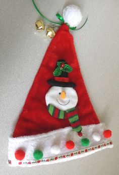 Plush red Santa hat for ugly Christmas sweater party wear