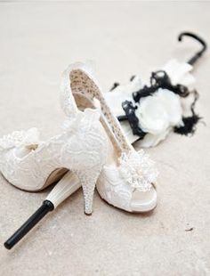 White lace and pearl wedding shoes.