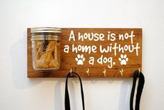Show your pet some love with this dog treat and leash holder. Made from solid wood and features a mason jar with lid for storing treats.