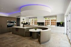Corian puts curves in all the right places This open plan kitchen with curved dining area is from the Charles Yorke Rio Valencia range.   The project designers, Charles Yorke retailer Jones Britain, chose DuPont™ Corian supplied by CD UK for its thermoforming capabilities particularly for the island unit where the worktop opens out into a curved seating area. #kitchen