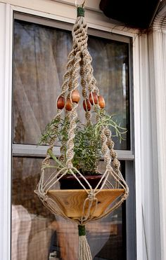 "yarn hanging planter baskets | Hemp: ""Swirly Things"" $20. approx. 33″ with planter , originally ..."