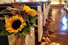 Big bright #sunflowers, burlap and leaves down the aisle are a creative way to decorate our chapel for a fall wedding!  wedding at Northeast Wedding Chapel  www.WaltersWeddingChapel.com  #chapelwedding  #pewflowers