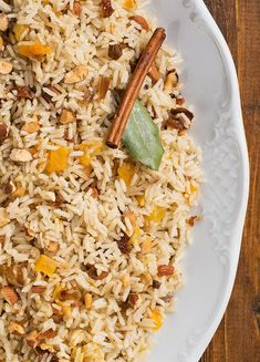 fragrant and exotic side dish recipe. Basmati rice gets cooked with dried fruit and spices for an unforgettable experience!A fragrant and exotic side dish recipe. Basmati rice gets cooked with dried fruit and spices for an unforgettable experience! Moroccan Rice, Morrocan Food, Moroccan Dishes, Greek Recipes, Indian Food Recipes, Vegetarian Recipes, Cooking Recipes, Healthy Recipes, Ethnic Recipes