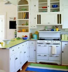 I like all the shelves around the stove and the cabinet on the left