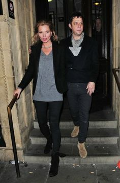 Kate Moss exited London's Royal Albert Hall in a cozy gray V-neck sweater, her signature black skinny jeans, a black blazer, and black suede boots.